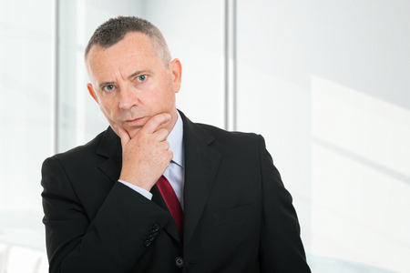 opting: Portrait of a pensive businessman