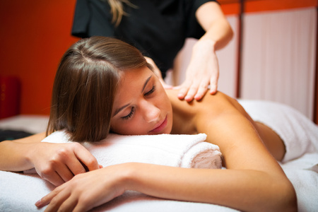 rubdown: Young woman getting a massage Stock Photo