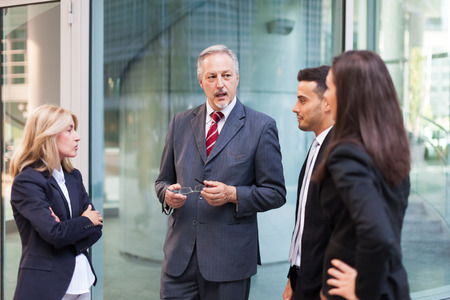 executive: Group of business people discussing about something