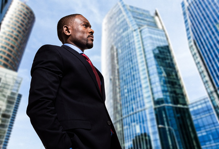 american banker: Portrait of a businessman in front of skyscrapers