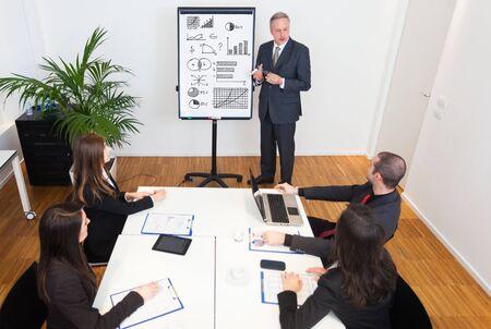 employee: Businessman explaining business concepts Stock Photo