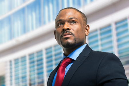 american banker: Portrait of a businessman in front of his office Stock Photo