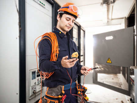 Portrait of an electrician at work in a transformer room Stock Photo