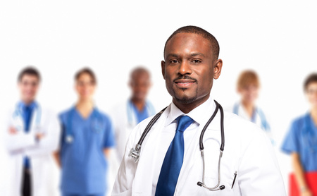 Portrait of a doctor in front of his medical team Stock Photo