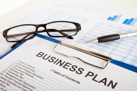 Business plan over financial charts