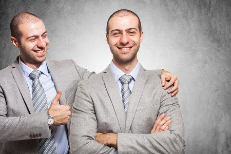 self worth: Smiling businessman congratulating with himself