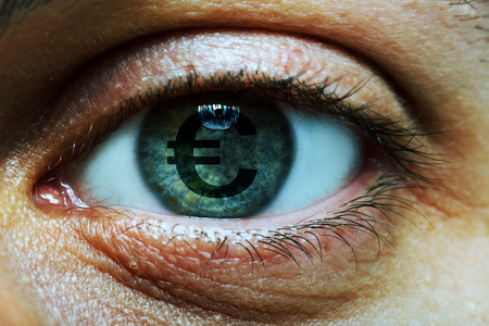 avid: Close-up image of a man with an euro symbol in his eye