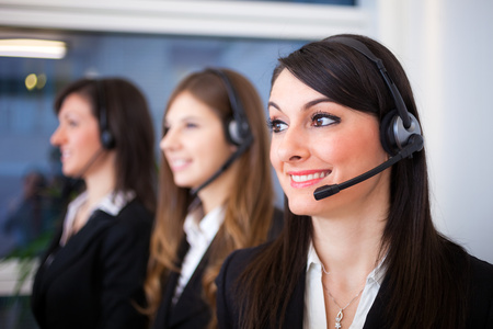 call girl: Portrait of a smiling customer representatives at work