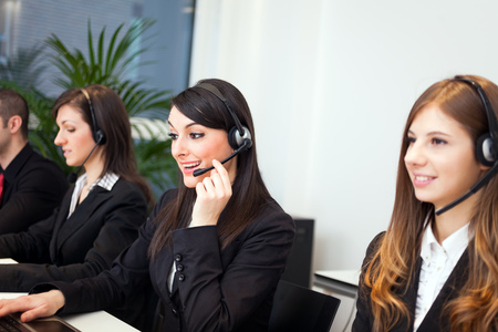 customer support: Portrait of a smiling customer representatives at work