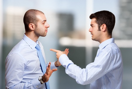 angry: Businessman scolding a colleague