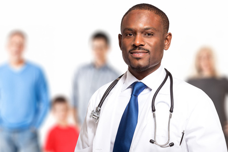 consultant physicians: Portrait of a smiling family doctor Stock Photo