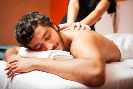 back rub: Man having a massage in a wellness center