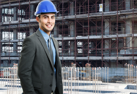 Portrait of an architect in front of a construction site photo