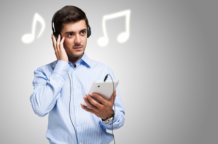 music listening: Young man listening music