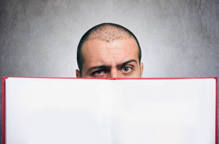 Close-up of a man holding an open blank book photo