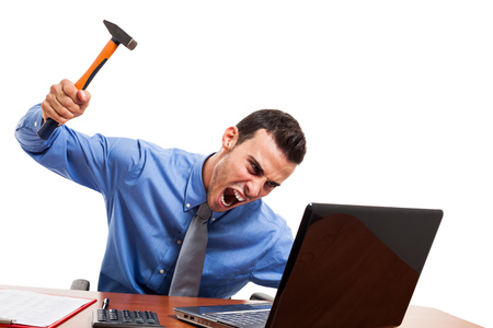Angry man smashing his laptop photo