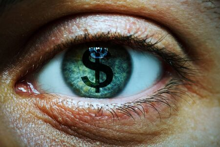 Close-up image of a man with a dollar symbol in his eye photo