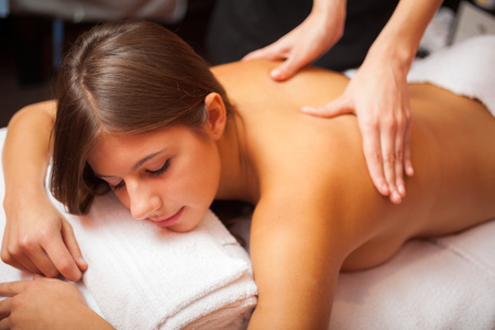 back rub: Beautiful woman having a massage Stock Photo