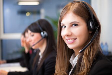 Female smiling customer support operator with headset portrait Stock Photo