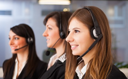 contact center: Portrait of three customer representatives at work