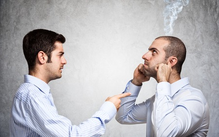 intolerable: Businessman scolding a colleague
