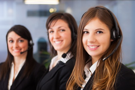 contact: Portrait of three customer representatives at work