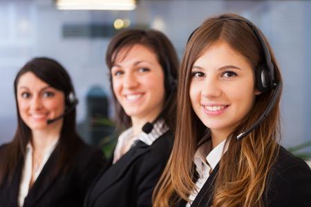 representatives: Portrait of three customer representatives at work