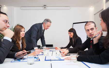 work group: Group of business people at work Stock Photo