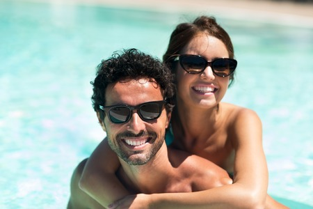 a couple: Young couple having fun in the water Stock Photo