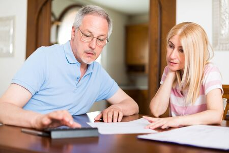 penniless: Couple calculating their expenses together Stock Photo
