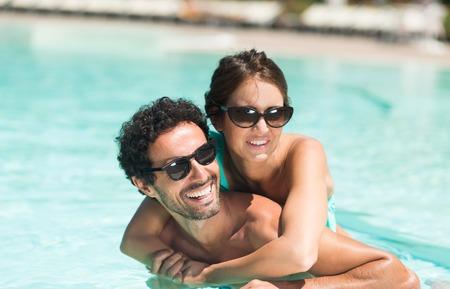 swimming pool woman: Young couple having fun in the water Stock Photo