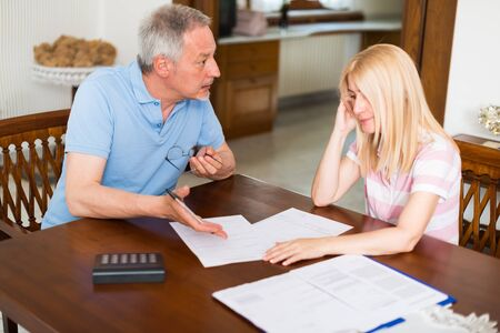 home expenses: Couple calculating their expenses together Stock Photo