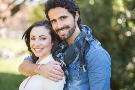 happy wedding: Smiling couple in a park Stock Photo