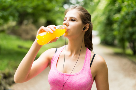 Young woman drinking after sport Stock Photo
