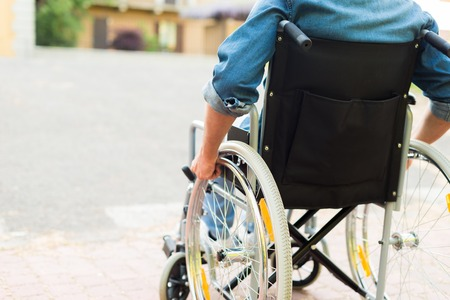 Detail of a disabled man trying to getting on a ramp Stock Photo