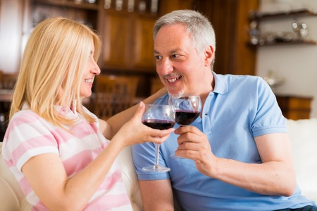 syrah: Portrait of a mature couple drinking a glass of red wine
