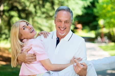 active people: Portrait of an happy mature couple having fun
