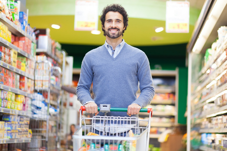 one family: Attractive man shopping in a supermarket