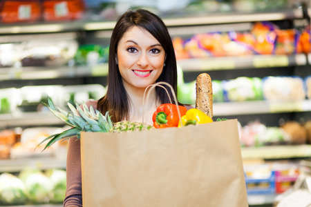 young female: Woman shopping in a supermarket Stock Photo