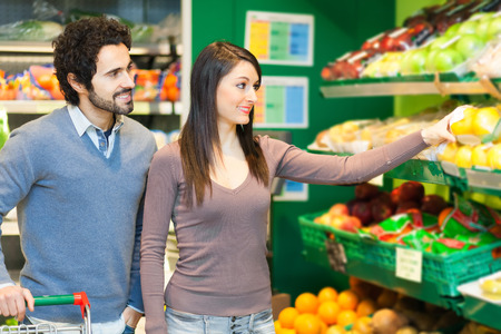 expiration: Couple shopping in a supermarket