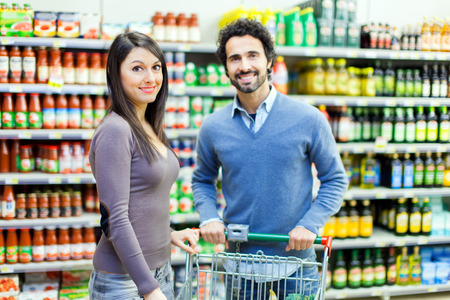 woman shopping cart: Couple shopping in a supermarket