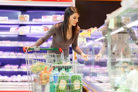 hypermarket: Attractive woman shopping in a supermarket