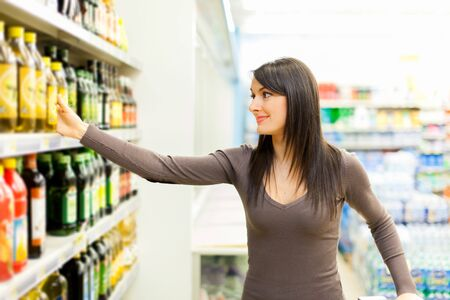 impersonal: Woman shopping in a supermarket Stock Photo