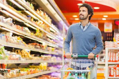 shopping cart: Man shopping in a supermarket