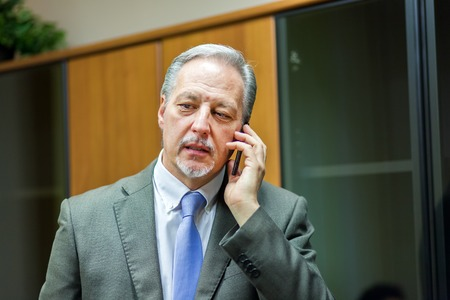 bank manager: Businessman talking on the phone