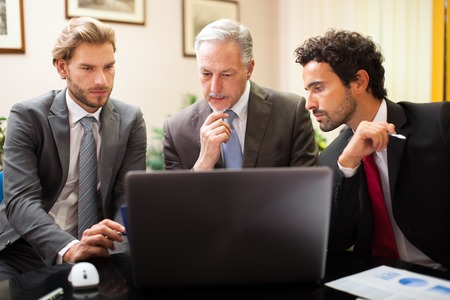 management team: Business people at work in their office Stock Photo