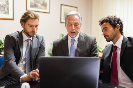 only 3 people: Business people at work in their office Stock Photo