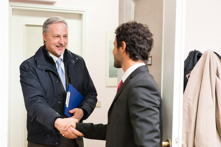 just arrived: Businessman welcoming a guest in his office Stock Photo