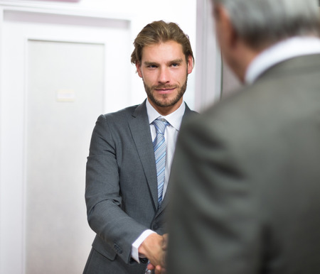 just arrived: Business people shaking hands