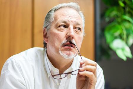 decisions: Portrait of a pensive businessman